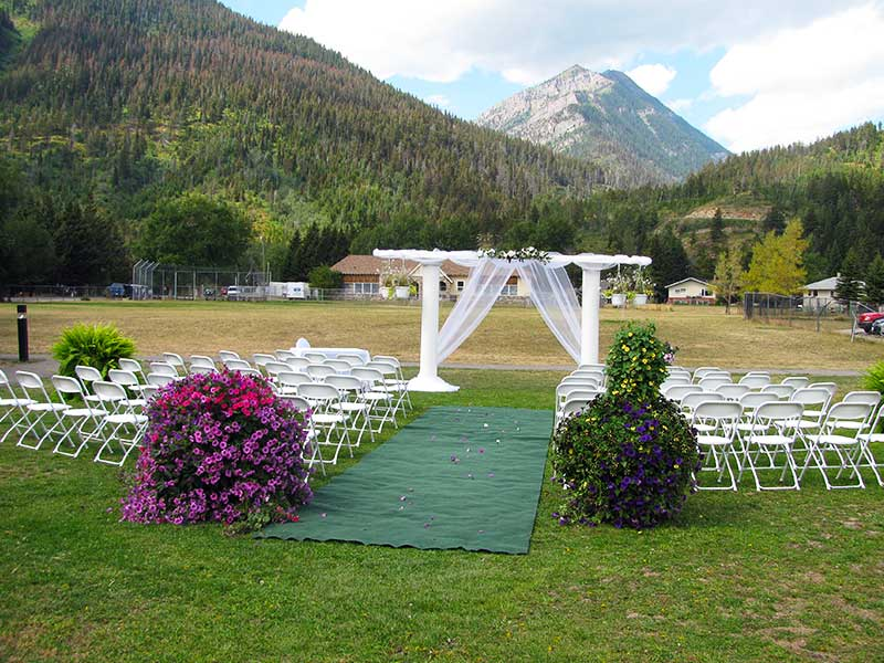 The Beargrass Aisle archway setup for a summer wedding in Waterton Lakes Nation Park.